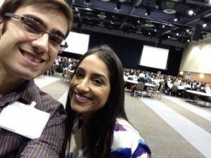 Two graduate students attending the kick-off of the annual IPE event of over 800 students